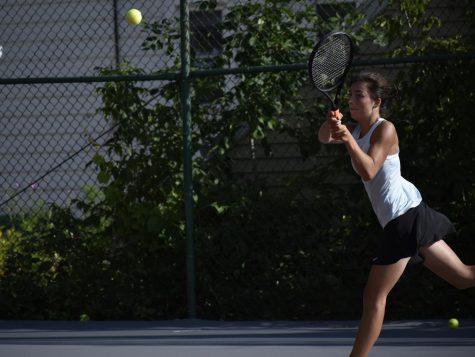 Margaret Bugnacki, senior, hits the ball. Girls tennis has a large turnout this year.
