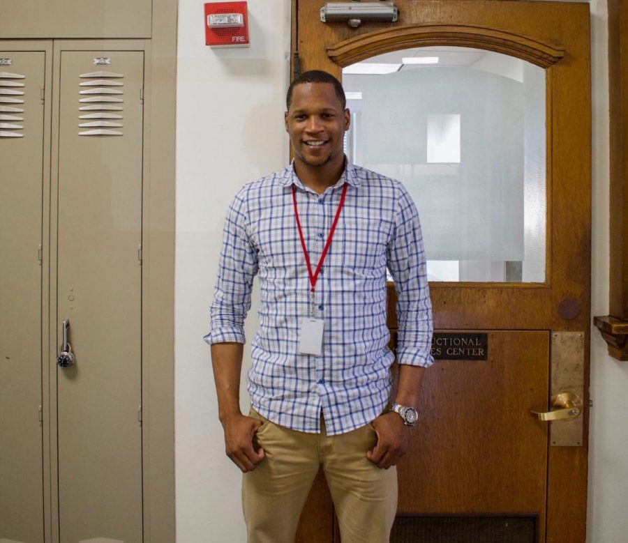 Samuel Coleman smiles for the camera. Coleman is the new Equity Director, a position created this year.