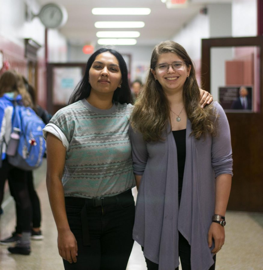 Mira Lee Prabhu (left) and Julia Appel (right) smile for the camera. The two seniors were recently granted the right to vote on the Human Relations Commission.