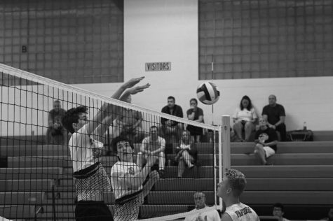 Henry Claussen, sophomore, and Colin Kenney, senior, block a shot from a recent opponent. The team currently has an eight-game winning streak.