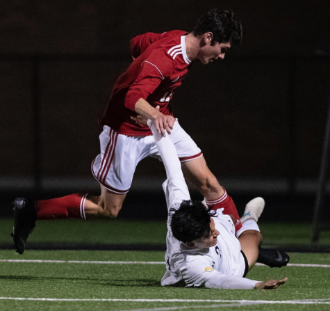 Alek Kovalcik fights for the ball against a Greenfield player. Boys soccer has had much success with a young team this season.
