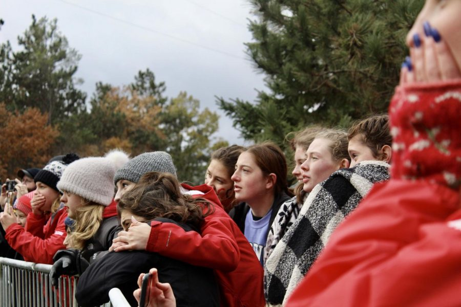 The girls huddle together after the state meet. The girls cross country team won state for the first time in program history.