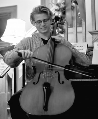 Nicholas Emanuelson, junior, plays his cello in his living room. His parents are both high school orchestra teachers and make sure he practices daily.