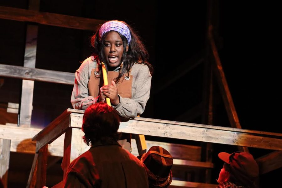 Nimya Harris sings in the  spotlight during her character's solo number. Harris is praised for her performance as Penelope Pennywise, along with all of the acting in the show.