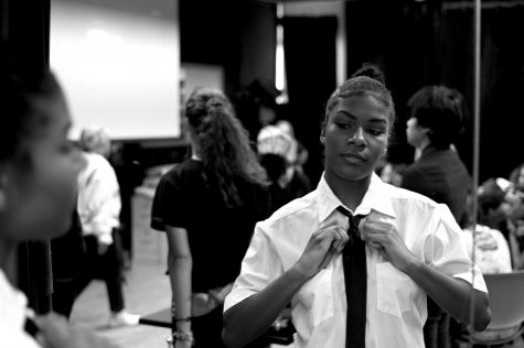 Trinity Higgins, senior, gets ready backstage before the performance begins.