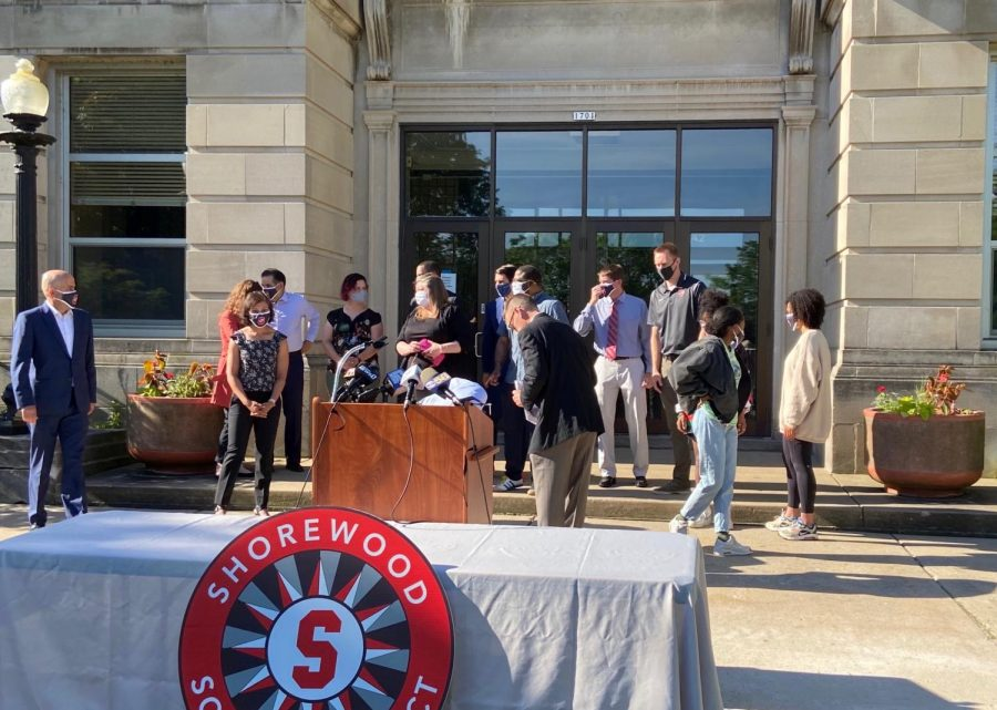 Students and administration stand on the steps of the high school getting ready for the press conference on June 8. In the press conference, superintendent Dr. Bryan Davis called on the Milwaukee District Attorney to elevate Stephanie Rapkin's charges to a hate crime