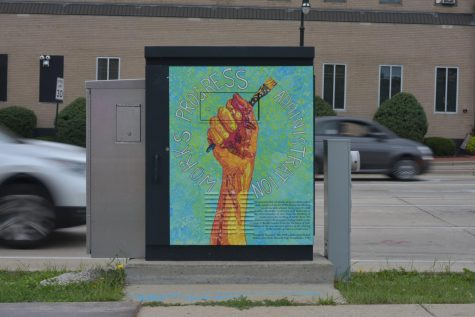 "A painted traffic box on the corner of Capitol and Oakland. This box is one of many in the project called ""Signaling History."""
