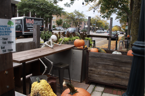 A skeleton bows his head at an outdoor table at Draft & Vessel. The establishment, like many others, is wondering how they will safely serve customers as the chillier months approach.