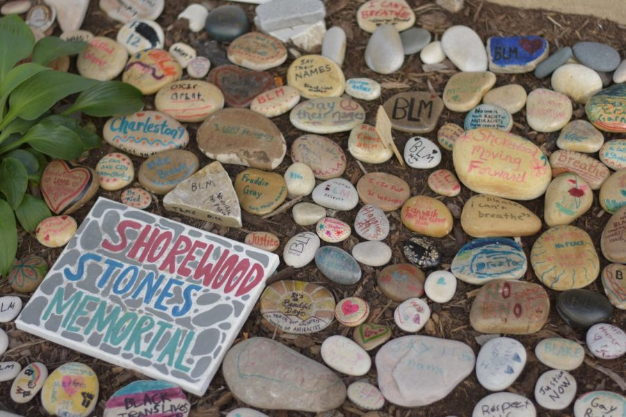 Decorated stones lay scattered at the rock garden exhibit next to MOD Pizza. The event was held to create a space for conversations on race mediated through art.