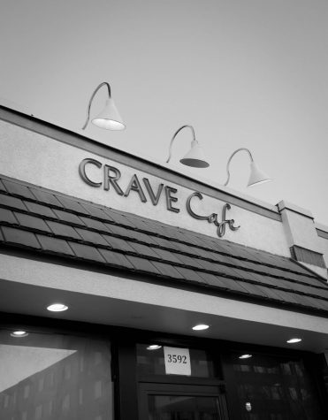 "The exterior of Crave Cafe on Oakland Ave. They serve American style burgers ""with a twist."""