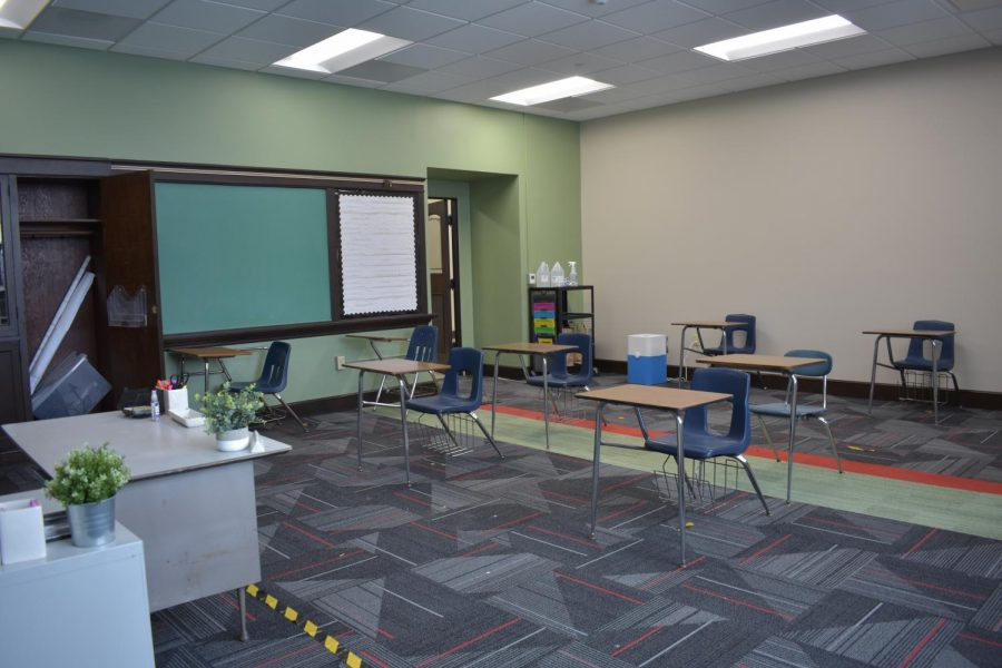 A newly-renovated classroom arranged with distanced desks and hand sanitizer at the door to fit COVID guidelines. Hybrid students will return to school on February 22.