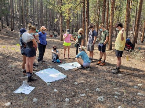 Juliet Peterka, junior, learns how to read maps with her classmates while backpacking. First semester, Peterka attended High Mountain Institute in Colorado, which provides various outdoor experiences for students.