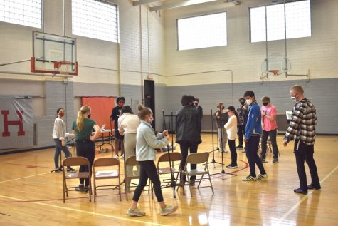 Students rehearse for the spring musical, Working, in the North Gym. There are a total of 14 cast members in the production, which will be filmed over the course of two weeks.