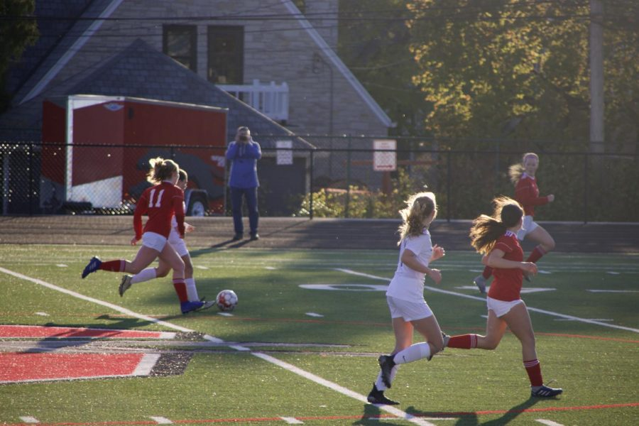 Becca Cheever, junior, chases down the ball. The girls soccer team has had a lot of injuries so far and have yet to start the same lineup twice.