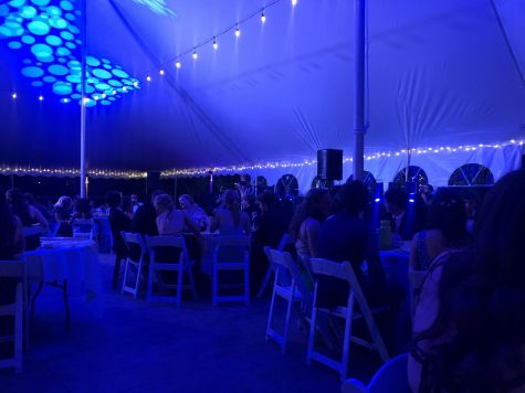 Students sit under the prom tent. The event was disappointing for many students.