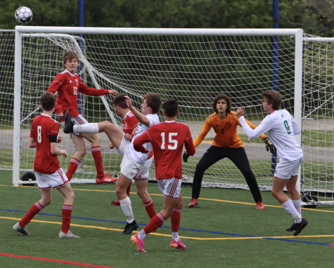 Antonio Rodriguez goes up for a header as the greyhounds defend a cross. The state semi-final game was very physical, and ended with a 0-1 Shorewood defeat.