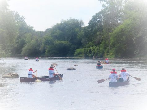 Watershed students canoe down the Milwaukee River. They canoed from the headwaters of the Milwaukee River to the waters of Lake Michigan.